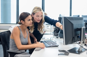 Businesswomen using desktop computer in modern office