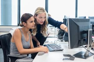 Businesswomen using desktop computer in modern office